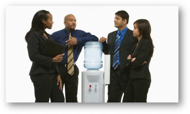 Office workers around watercooler